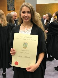 Photo of Siobhán Maxwell with certificate at scholarship ceremony in UCD