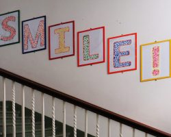 SMILE wall sign