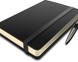 Picture of black diary and pen